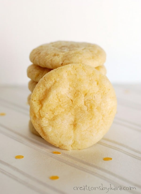 stack of lemon crinkle cookies with one in front