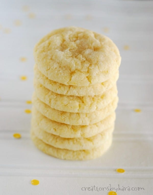 tall stack of lemon crinkle cookies on a white table