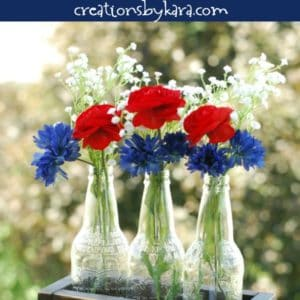 4th of july centerpiece with flower vases in a wood box