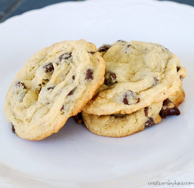stack of three soft chocolate chip cookies on a plate