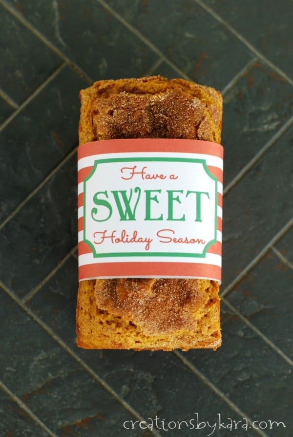 pumpkin cinnamon swirl bread with a Christmas bread wrapper
