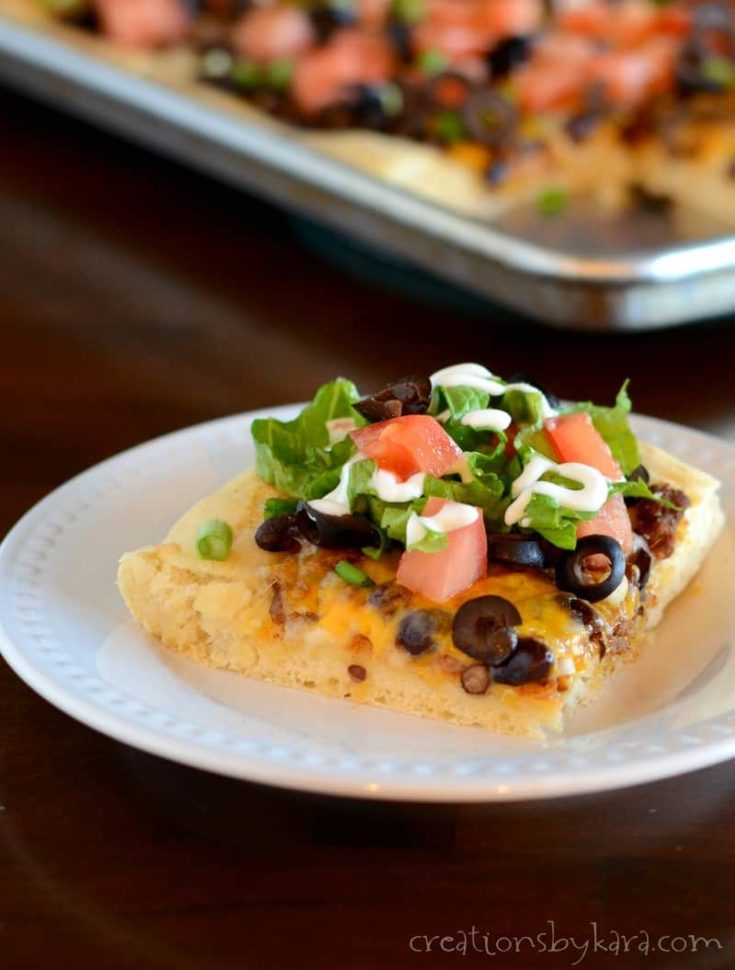 This Taco Pizza was a huge hit for dinner at my house! It's a fun way to serve two classics.