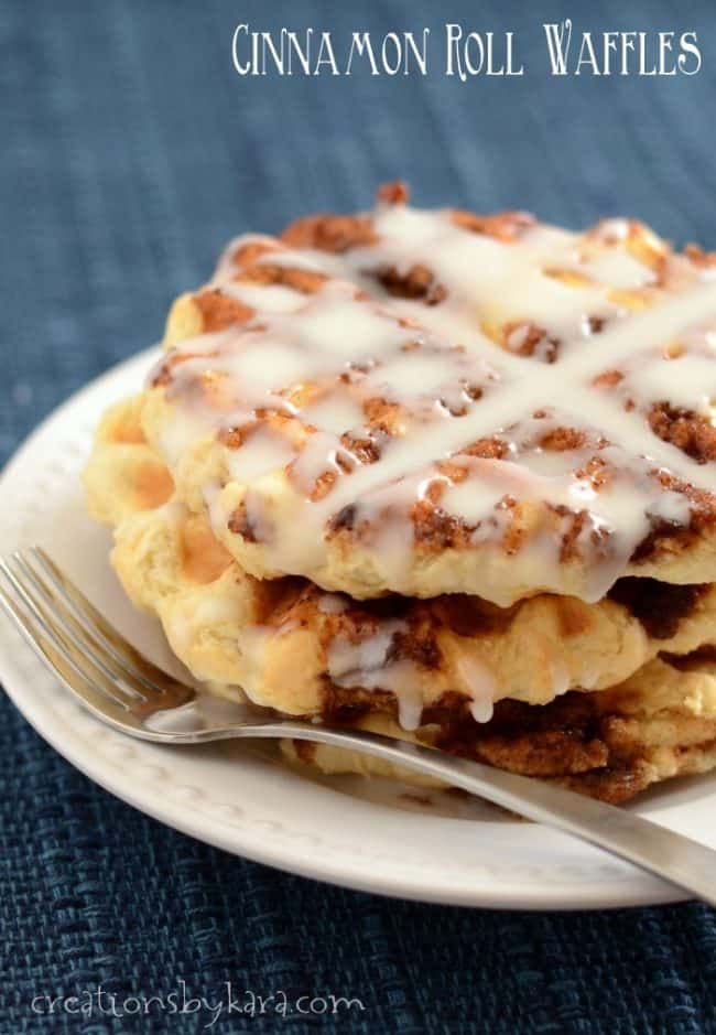 plate of cinnamon roll waffles with icing