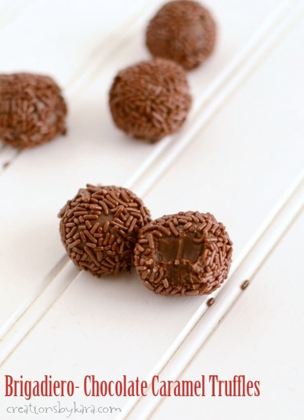 Brigadeiro truffles, one with a bite taken out of it
