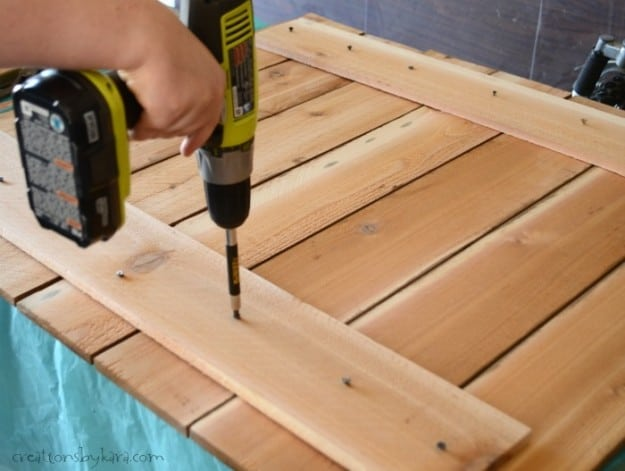 assembling a cedar fence slat sign with power drill