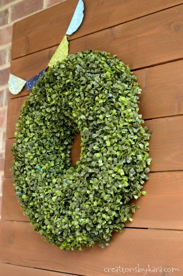Boxwood Wreath on rustic wood sign