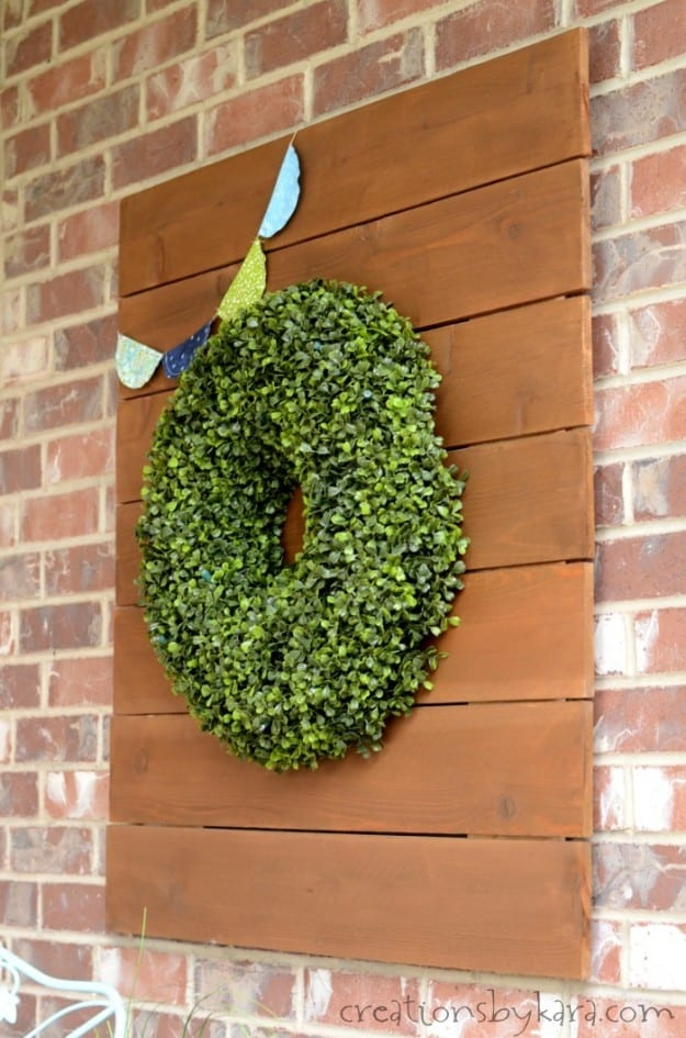 Rustic wood sign with hanging boxwood wreath