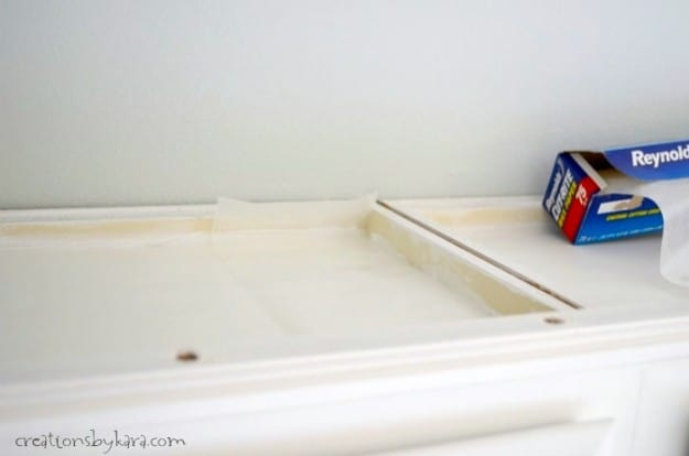 Cleaning Tip- How to keep the top of your cabinets clean and never have to dust them again!