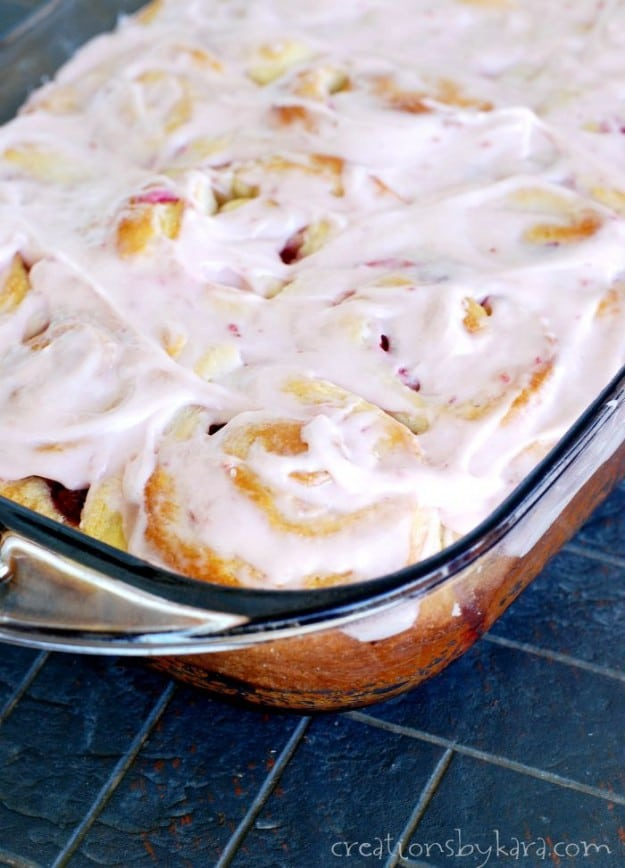 pan of frosted raspberry sweet rolls