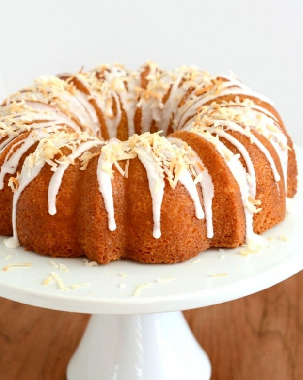 coconut cake drizzled with icing and topped with toasted coconut