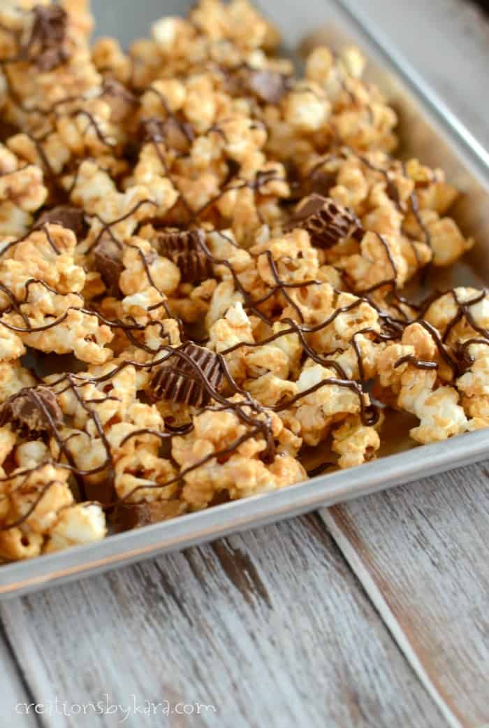 pan of popcorn with peanut butter and reeses