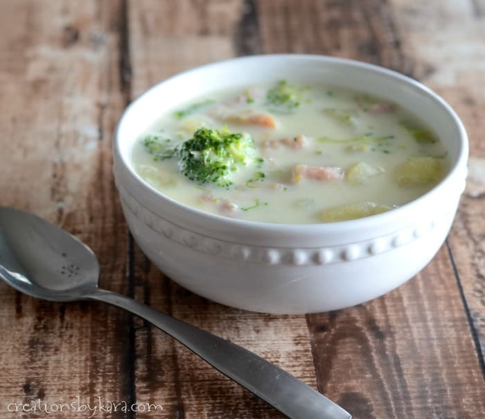 bowl of ham and broccoli soup with a spoon
