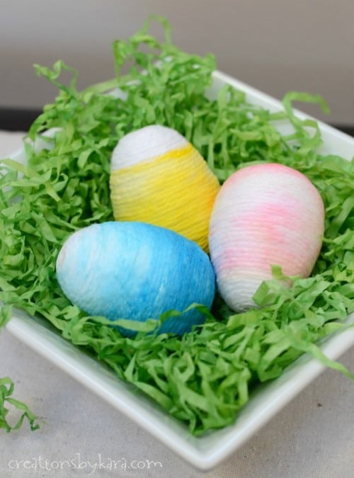 How to make Yarn Wrapped Ombre Easter Eggs. So fun for spring and Easter decor!