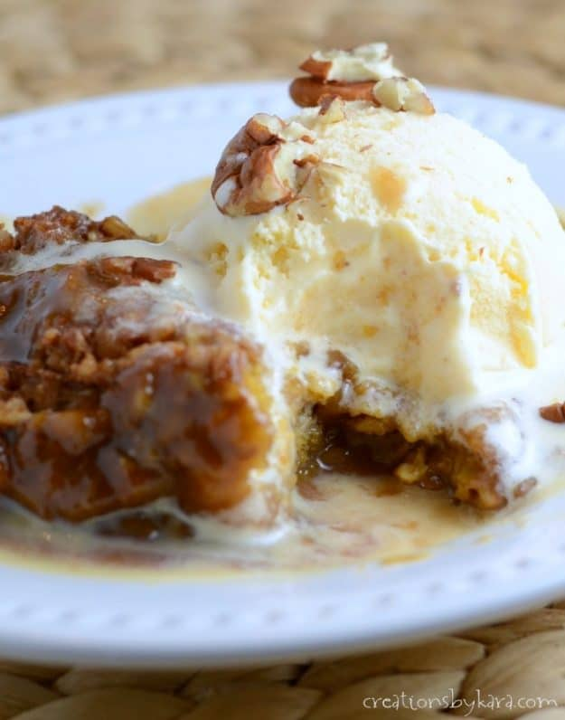 Packed with pumpkin spice flavor, this Pumpkin Cobbler is easy to make and absolutely scrumptious! Vanilla ice cream is a must!