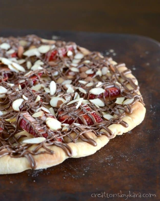 Strawberry Nutella Dessert Pizza on baking stone