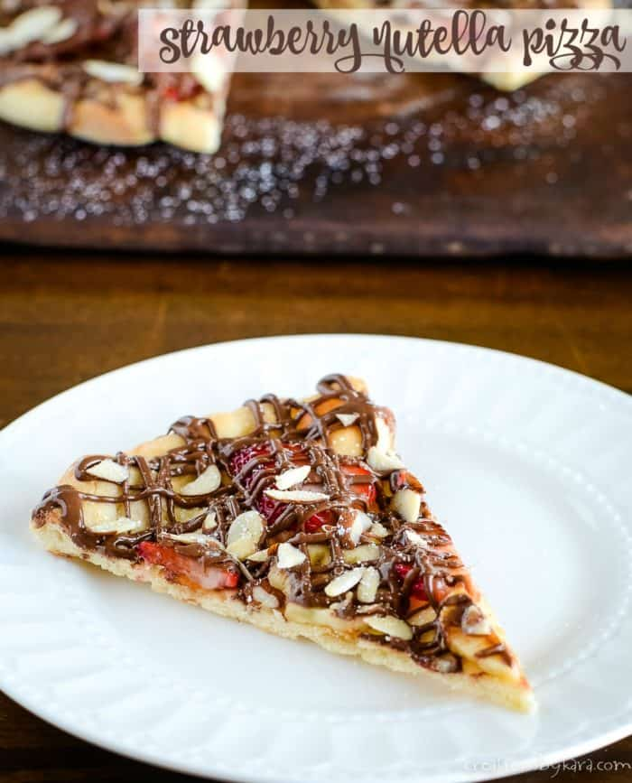 slice of strawberry nutella dessert pizza on a white plate