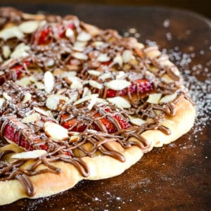 strawberry nutella pizza on a pizza stone