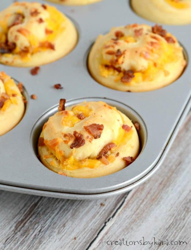 muffin tin with bacon and cheese rolls