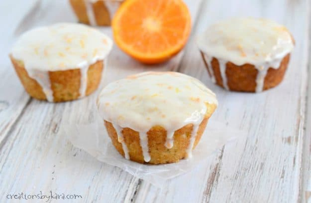 banana muffins dripping with orange sour cream glaze