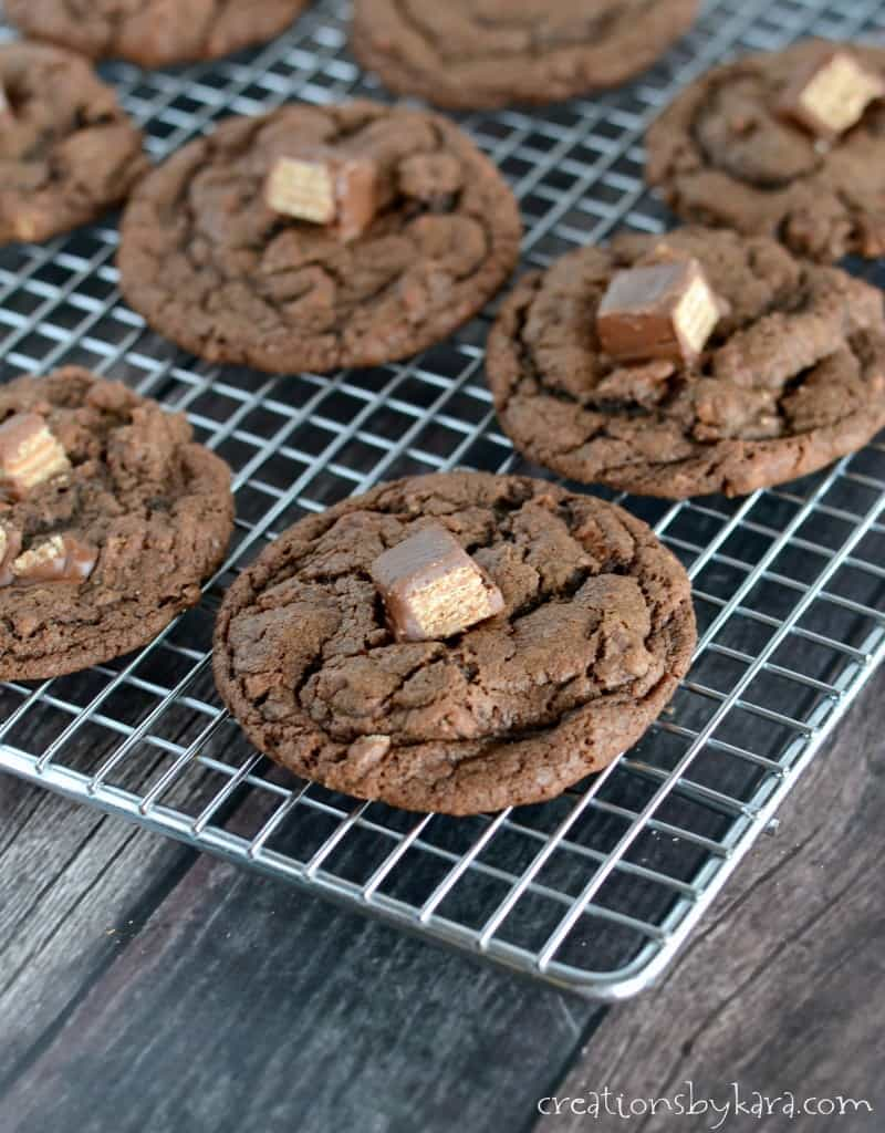chocolate cookies with kit kats on a cooling rack