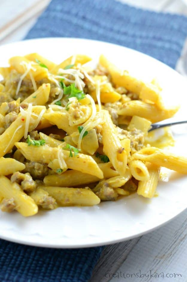 Savory Pumpkin Pasta is a quick and easy weeknight dinner recipe. Sausage makes this pasta dish extra flavorful!
