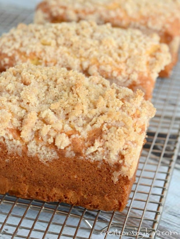 loaves of eggnog quick bread with crumb topping on a cooling rack