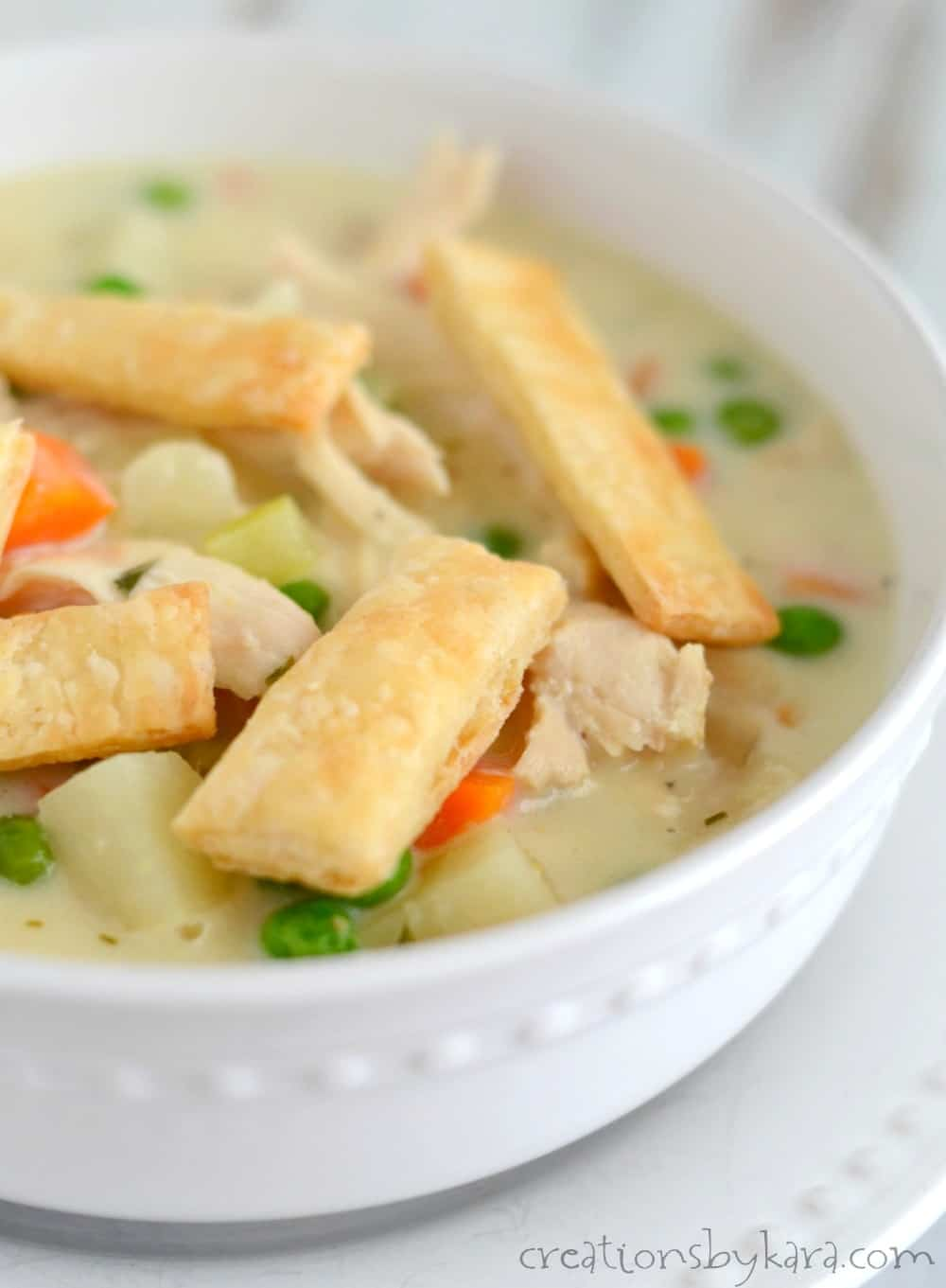 Chicken Pot Pie Soup served with crispy, buttery pie crust strips. A delicious soup recipe the whole family will enjoy.