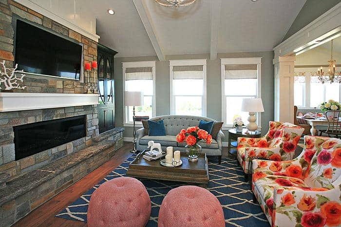 coral family room with touches of navy and gray