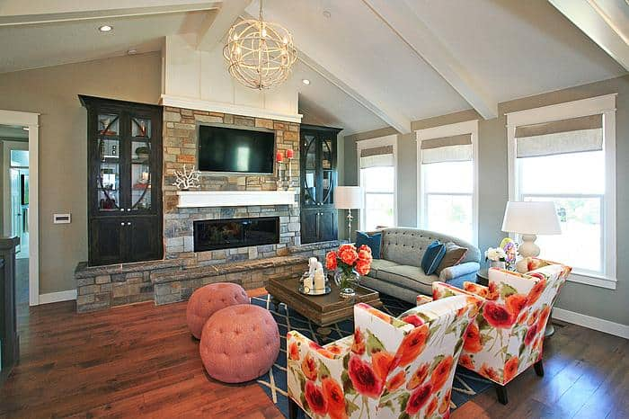 navy and coral family room with wall fireplace