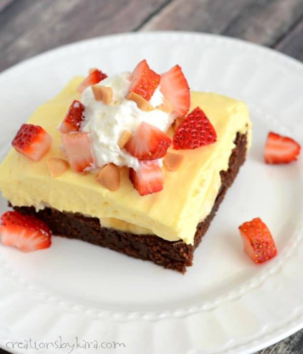 Fudgy brownies, bananas, pudding, strawberries, and cream. A luscious summer dessert recipe!