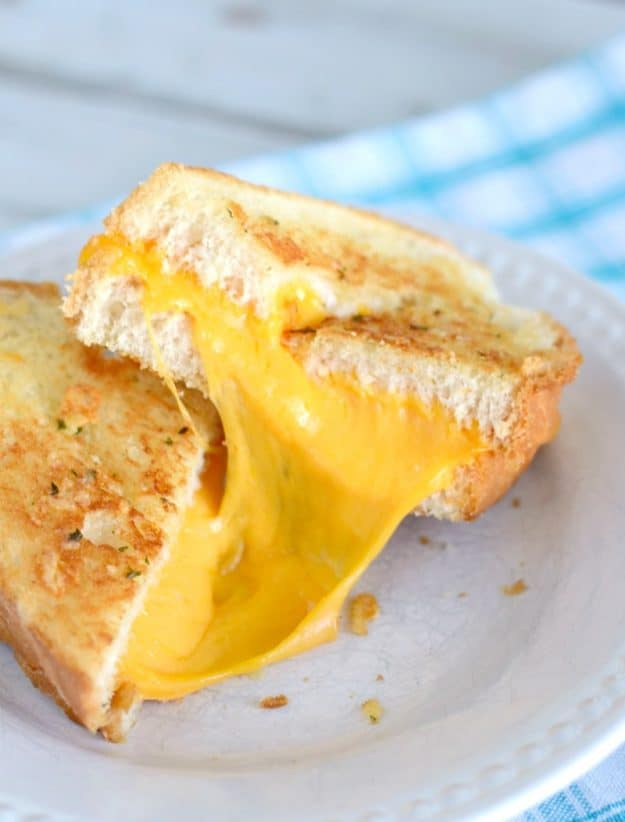 Oooey gooey garlic bread grilled cheese. An easy but tasty update on regular grilled cheese. Give them a try!
