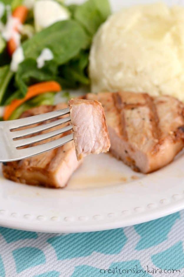 bite of pork chop on a fork