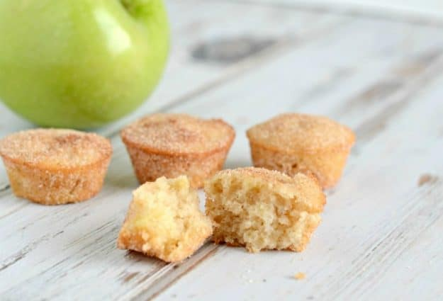 mini muffins with an apple in the background