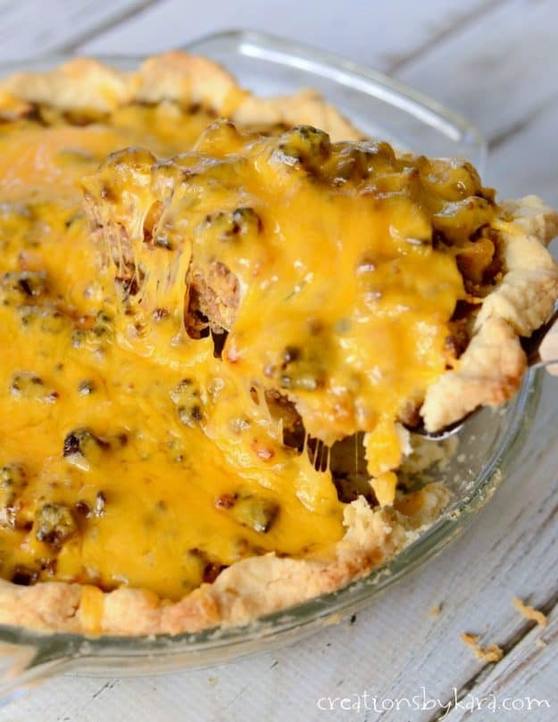 cheesy beef pie with bacon in a pie plate