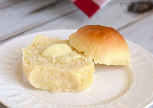 roll with butter on a plate