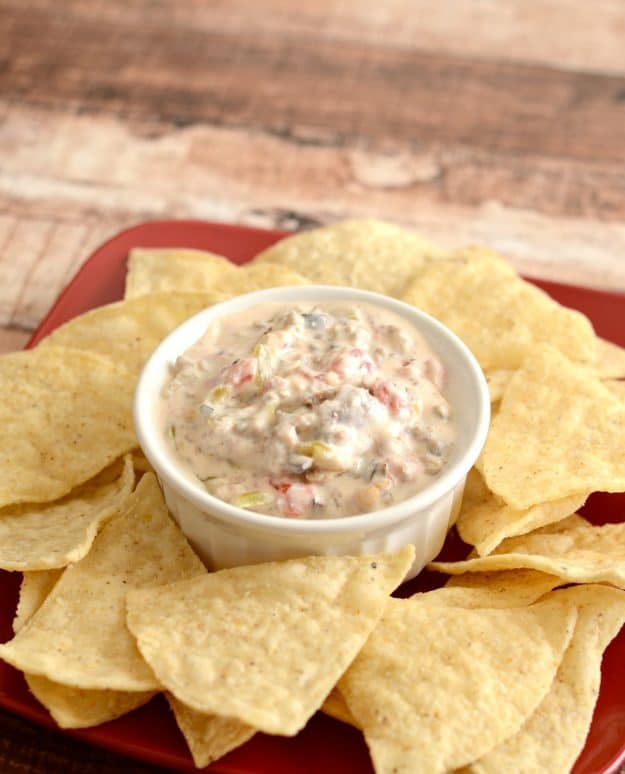 Recipe for the best hot sausage dip. Everyone raves about this slightly spicy sausage dip. It's incredible!