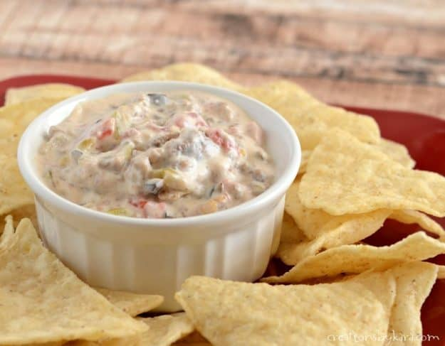 Serve this hot sausage dip with chips for an unbeatable appetizer or snack. Everyone loves this dip recipe!