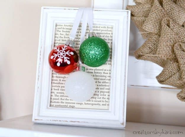 hanging ornaments in a frame on a shelf
