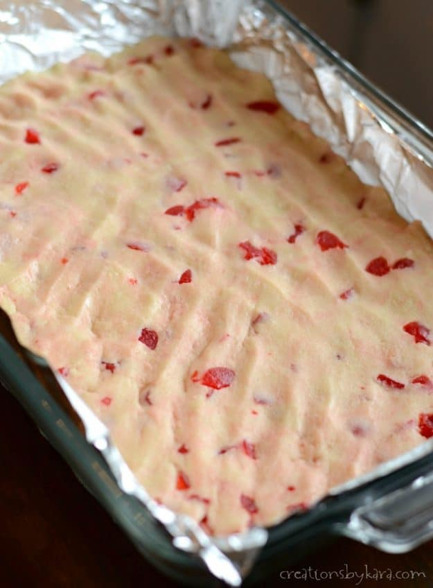 Recipe for Maraschino Cherry Sugar Cookie Bars with Cream Cheese Frosting.