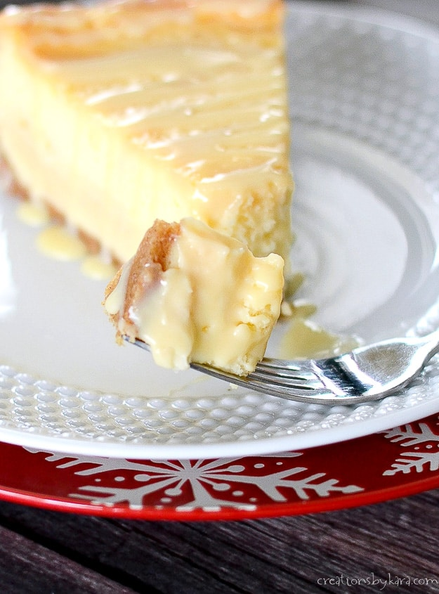 forkful of dulce de leche cheesecake drizzled with caramel
