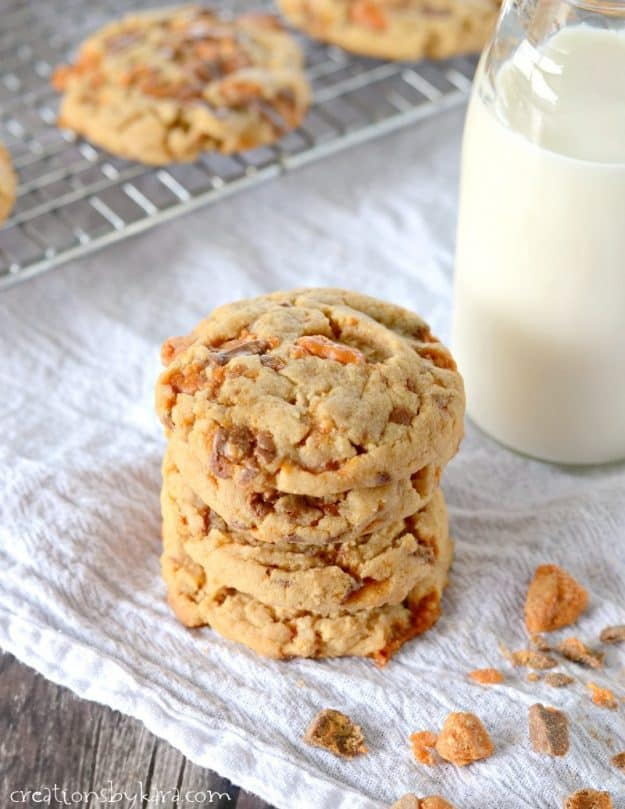 stack of butterfinger cookies with a glass of milk