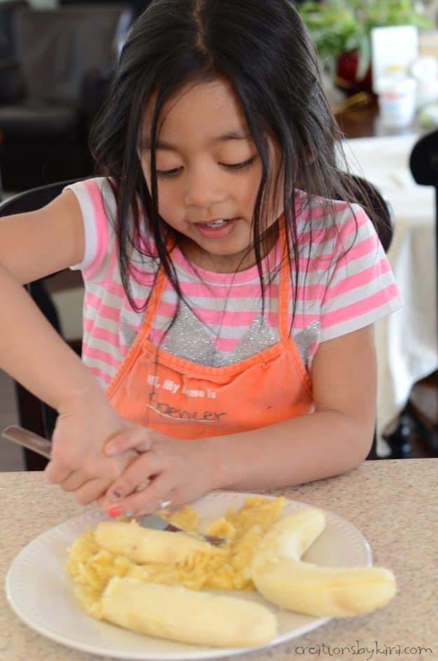 mashing bananas for double chocolate banana bread