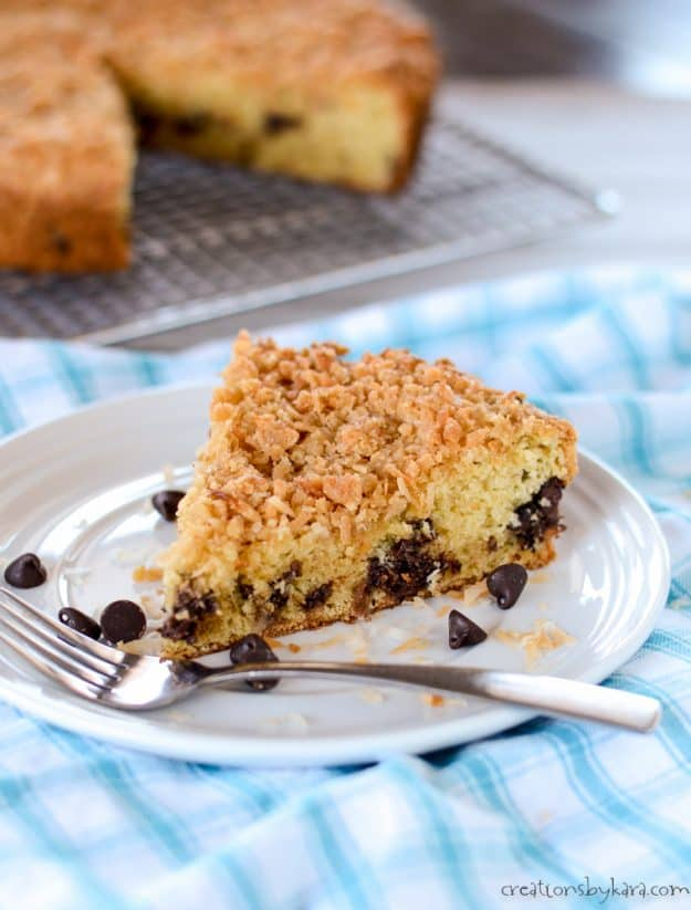 coconut coffee cake with chocolate chips on a plate with a fork