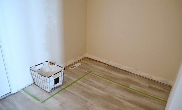 measuring the space for corner mudroom shelf