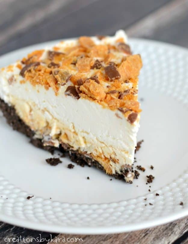 slice of frozen pie topped with crushed butterfingers