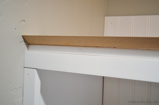 gusset for crown molding on top of cubbies