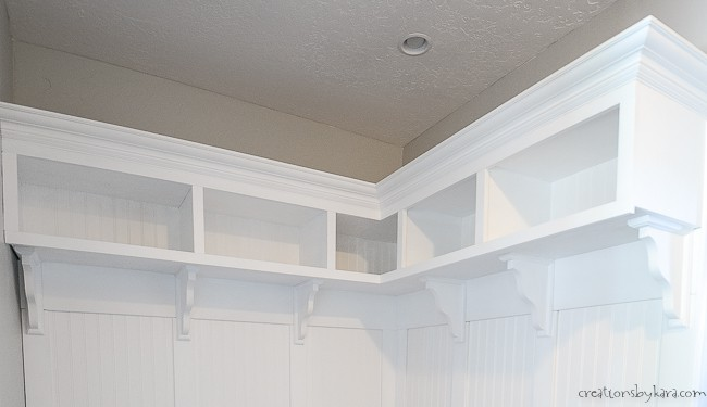 Corner mudroom bench cubbies with crown molding