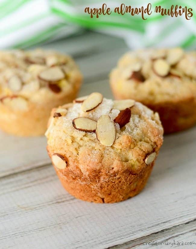 apple muffins sprinkled with sugar and sliced almonds