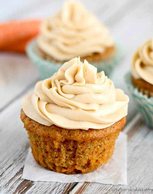 Carrot cake cupcake with swirls of brown sugar cream cheese frosting