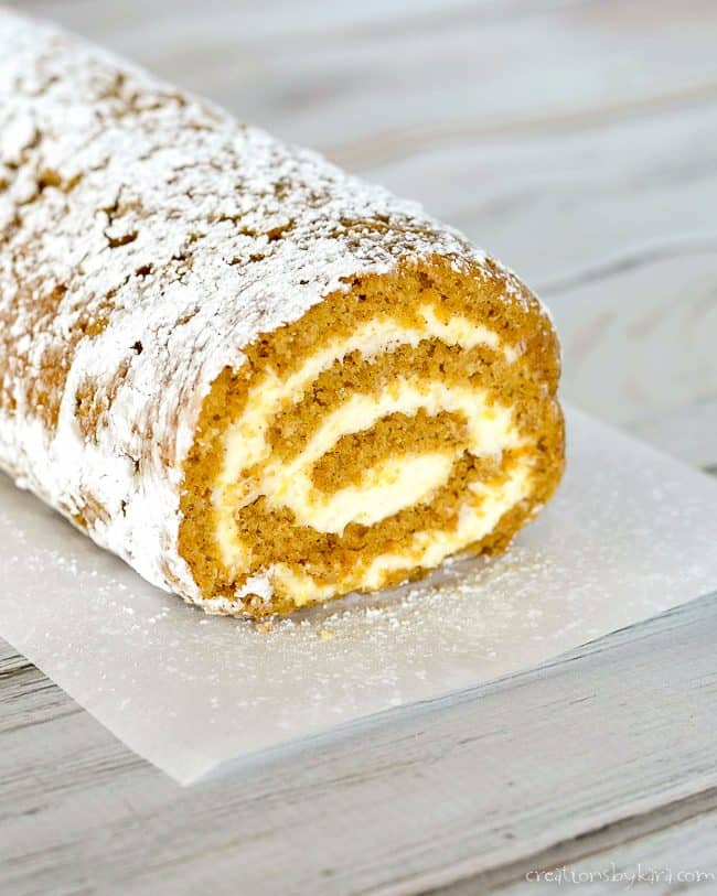 pumpkin roll sprinkled with powdered sugar